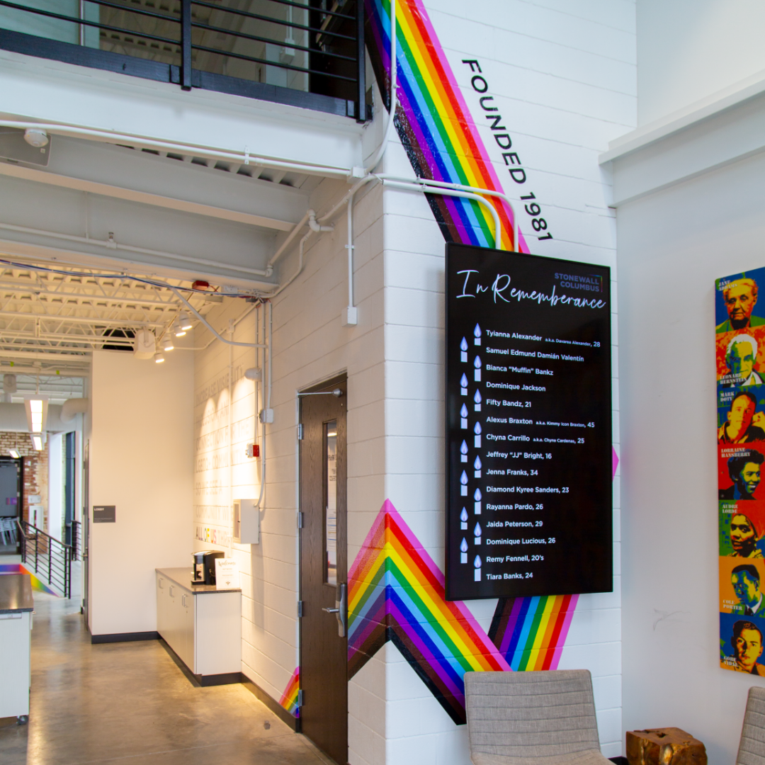 The front entry features a floor-to-ceiling rainbow graphic spanning two floors ainbow vinyl graphic at Stonewall Columbus Community Center by Continental Office Branding