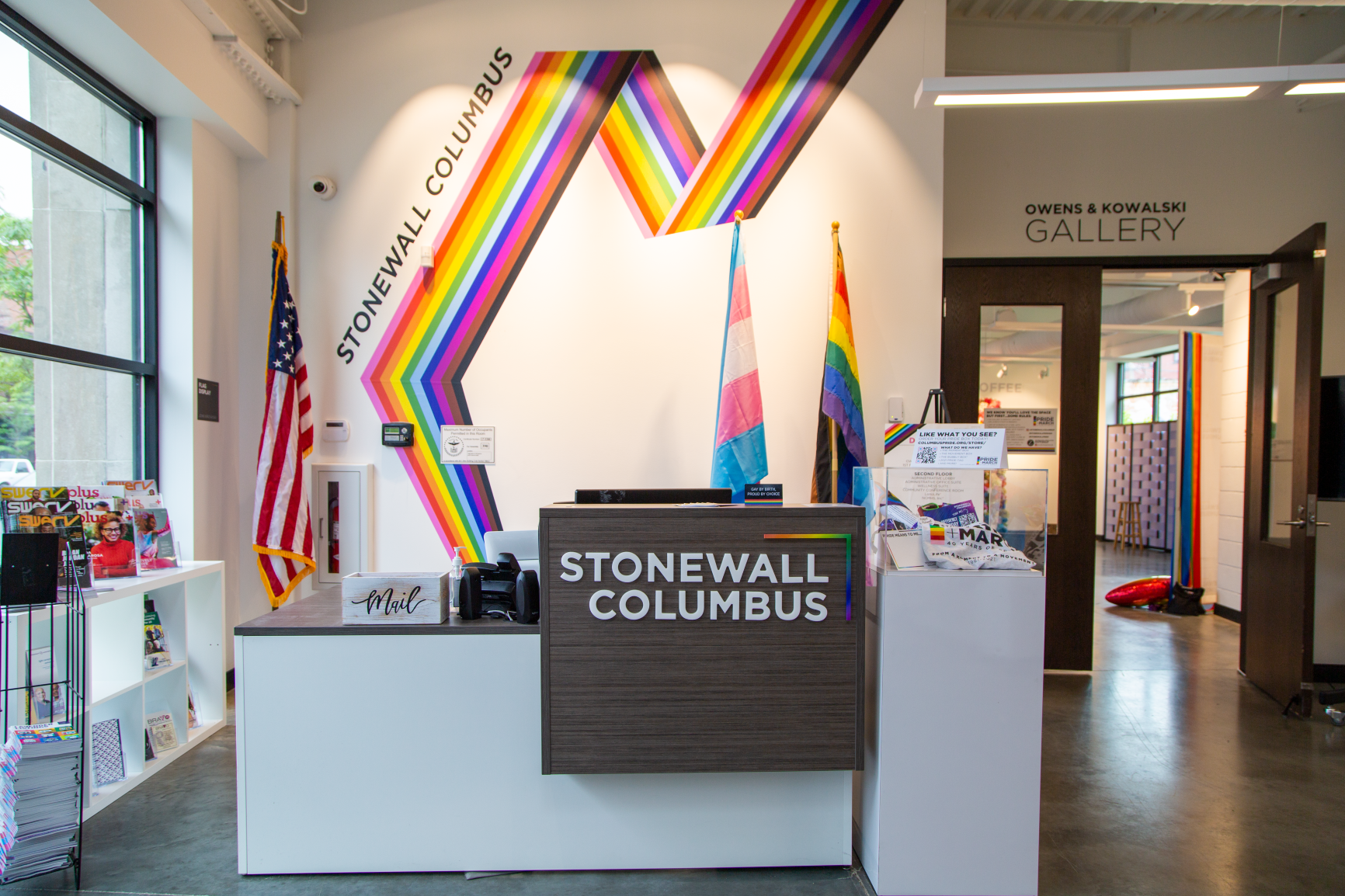 The front entry features a rainbow vinyl graphic that helps bring this space to life at Stonewall Columbus Community Center by Continental Office Branding