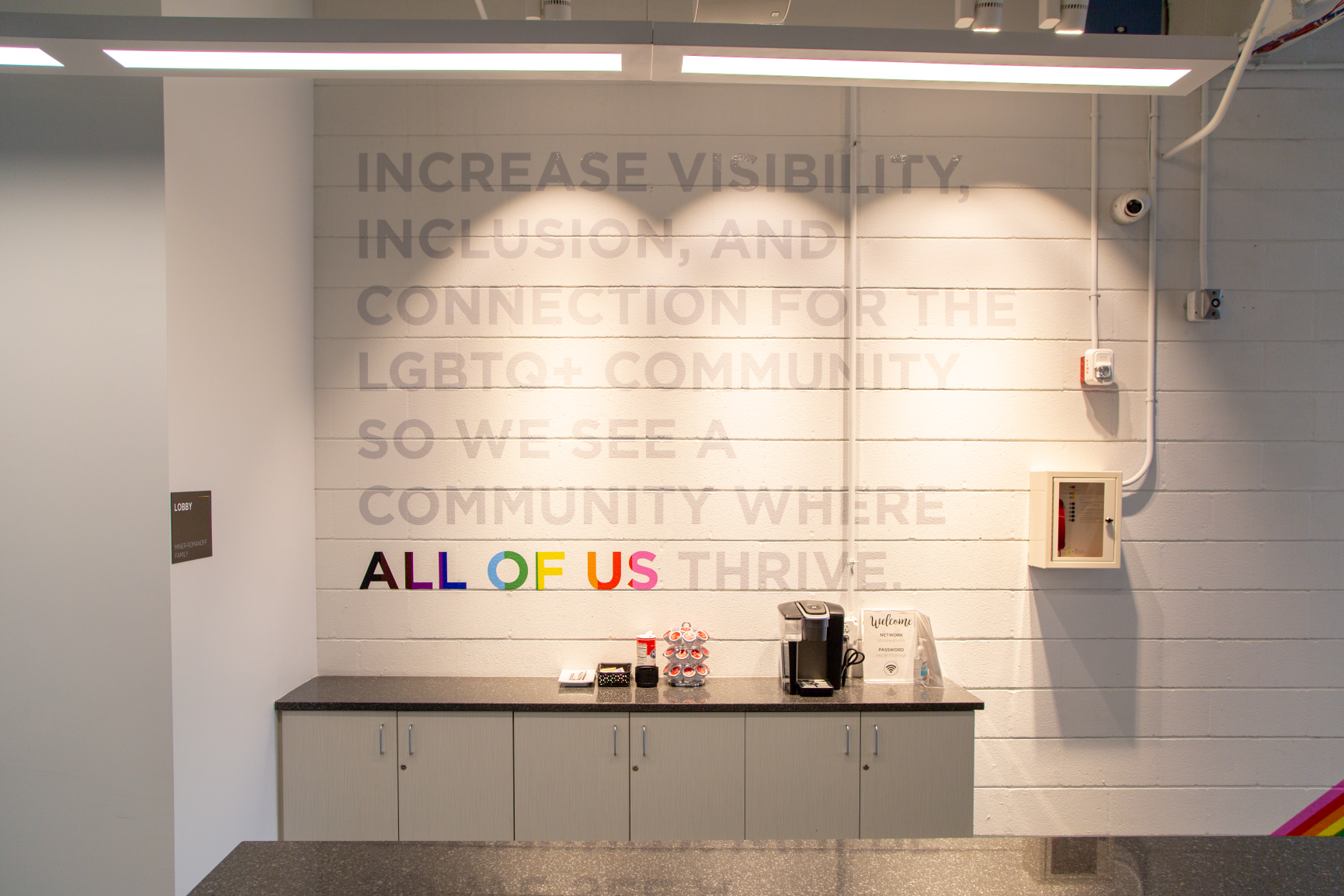 An inspirational message affirms Stonewall's welcoming and accepting mission at Stonewall Columbus Community Center by Continental Office Branding