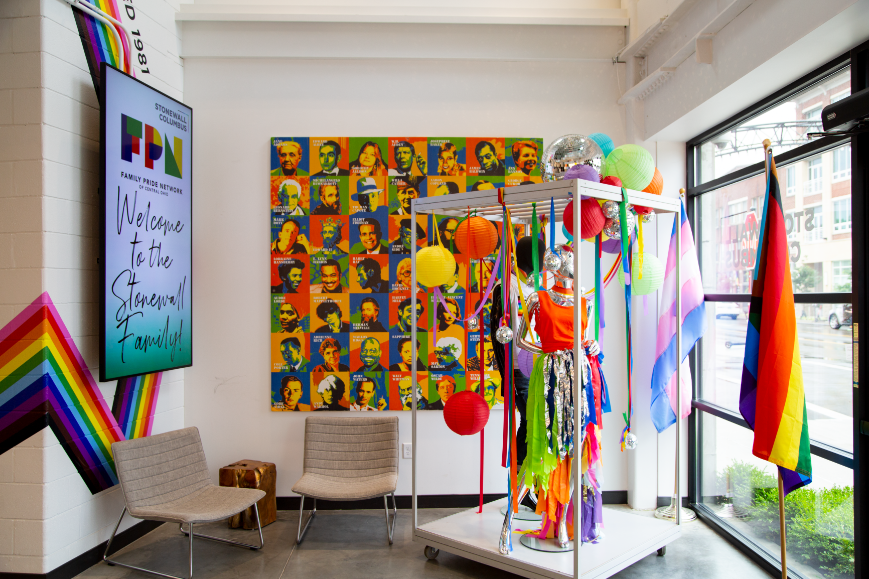 The space features afashion display along with a collage of influential leaders to showcase important LGBTQ+ history at Stonewall Columbus Continental Office Branding