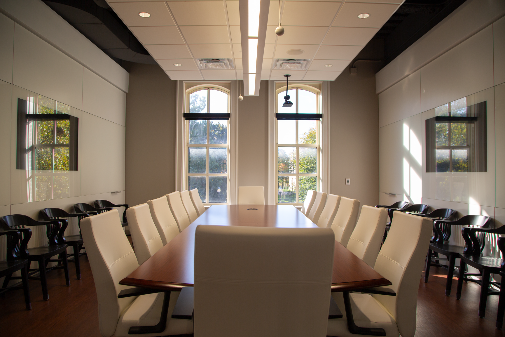 Modern, ergonomic chairs meet timeless, traditional style in this large conference room.