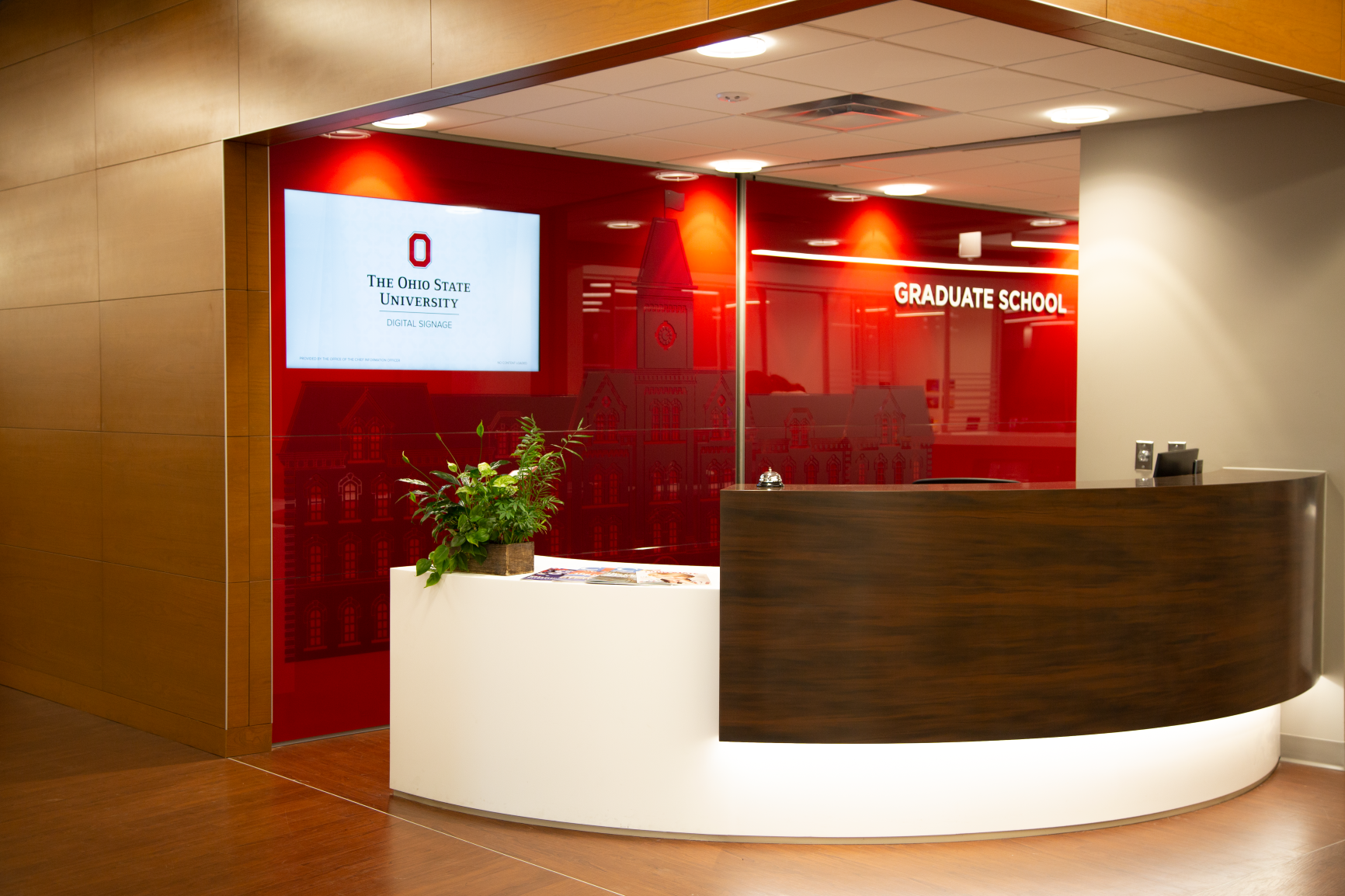 Custom DIRTT applications with integrated technology and custom branding greets guests at the Graduate School in University Hall at The Ohio State University by Continental Office
