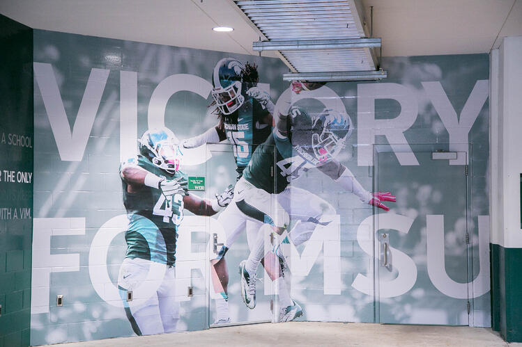 We created larger-than-life images on the walls to depict MSU's infectious spirit