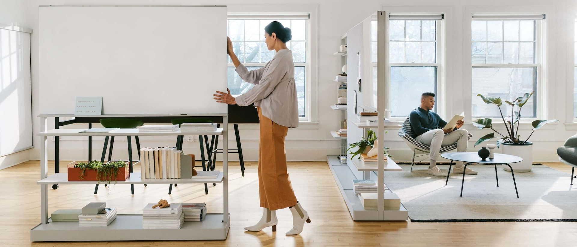 Workers rearranging the new Herman Miller OE1 collection for their work needs