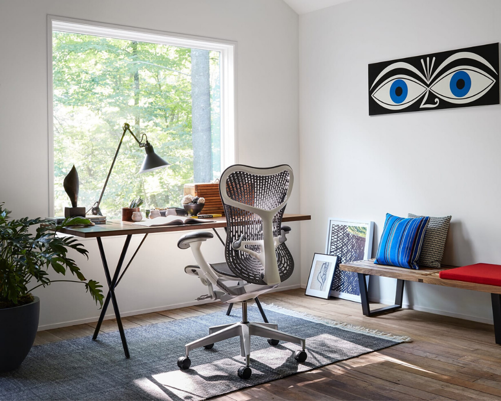A grey Herman Miller Mirra 2 chair faces a window in a work from home office setup Continental Office